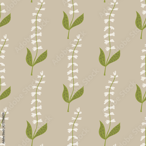 Fotografie, Obraz Seamless pattern of white tinkerbell flowers on a beige background
