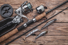 Fishing Tackle For Catching Predatory Fish. Wobblers, Spinning, Reel, Fishing Line On The Wooden Background