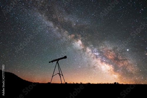 Fototapeta Silhouette of a telescope at the starry night and bright milky way galaxy. obraz