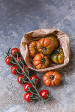 Sardinian Beef Tomatoes In Paper Bag And Ripe Of Mini Plum Tomatoes