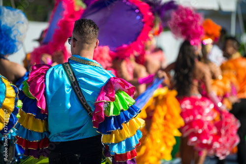 Foto auf AluDibond Rio de Janeiro Abstract view of samba dancers in colorful frilled costumes at a daytime Carnival street party in Rio de Janeiro, Brazil