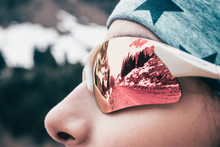 Female Model Close Up Face Sunglass Reflection In Winter Mountain.