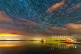 Star trails and Aurora Borealis behind Belhaven Bridge, Dunbar, East Lothian, Scotland