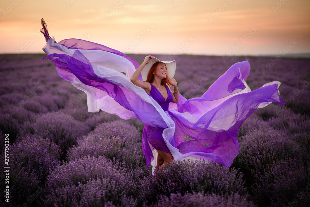 Fototapety, obrazy: Young happy woman in luxurious purple dress standing in lavender field