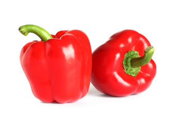 Tasty ripe red bell peppers on white background