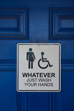 """Sign On A Blue Restroom Door Says """"Whatever Just Wash Your Hands"""" And Includes Male, Female, And Handicapped Symbols"""