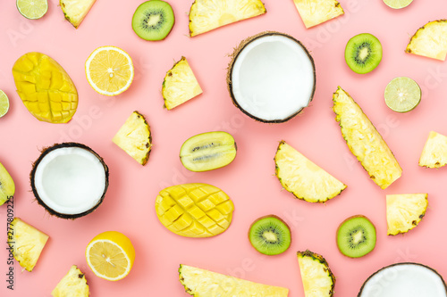 Table top view fruit tropical with spring summer holiday & vacation  background concept.Arrangement sliced various pineapple kiwi mango lemon and lime coconut on  pink paper.flat lay & pastel tone. - 277809225