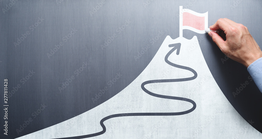Fototapety, obrazy: Business goal and success concept. Businessman drawing flag and mountain on chalkboard.