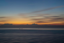 Beautiful Seascape With Boat In The Sea At Sunset Or Sunrise. Natural Light Background.