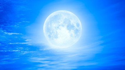 Night sky with blue moon in the clouds