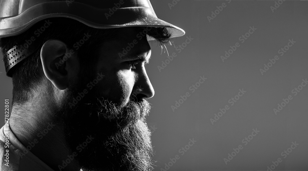 Fototapety, obrazy: Portrait architect builder, civil engineer working. Builder in hard hat, foreman or repairman in the helmet. Bearded man worker with beard in building helmet or hard hat. Man builders, industry.