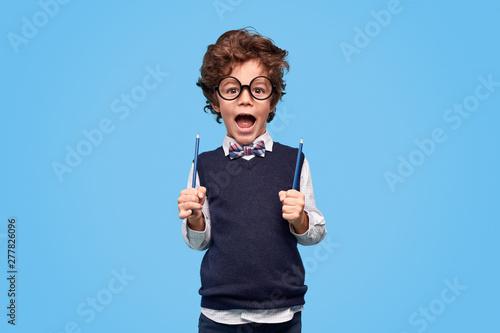 Fotografia  Funny little genius with pencils