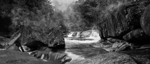 Devil's Pool Or Babinda Boulders Is A Mystical Natural Pool At The Confluence Of Three Streams Among A Group Of Boulders Near Babinda, Queensland, Australia. Black And White Photography. -Image.