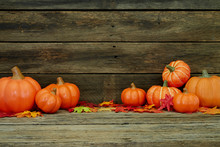 Autumn  Pumpkins And Leaves On Wooden