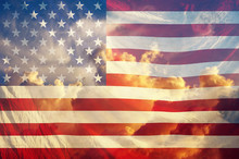 American Flag With Sky Background.