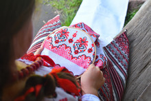 Girl Embroidery Rushnik.Hands Of Girl Woman Female In Ukrainian Traditional Shirt Sewing Embroidery Pattern In Embroidery Frame.