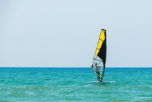 Windsurfing On The Background Of The Sea Landscape And Clear Sky, Windsurfer Men Go In For Sports, Copy Space.