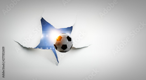 Paper torn hole effect with flying ball Wallpaper Mural