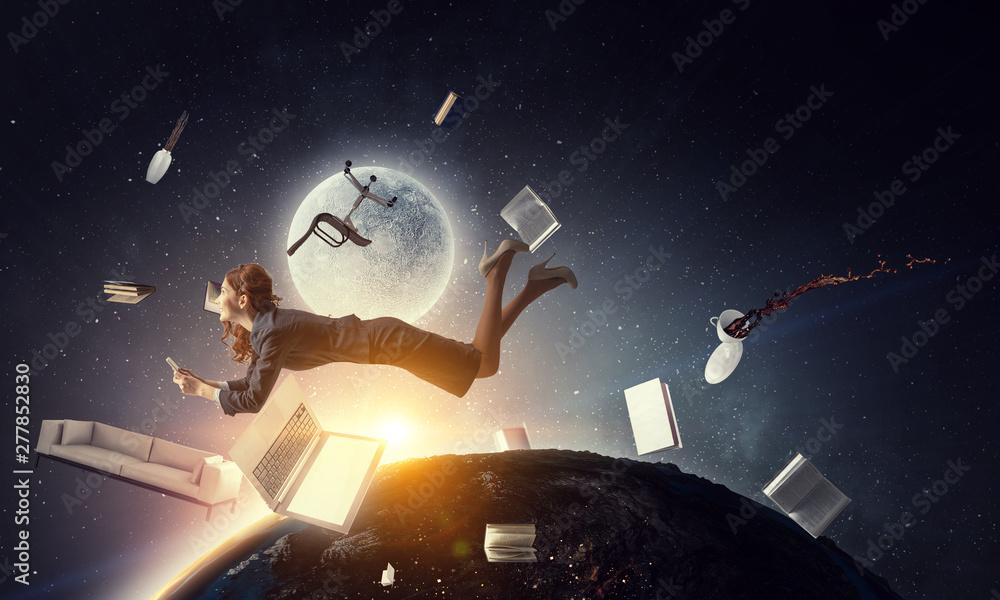 Fototapety, obrazy: Joyful beautiful young levitating businesswoman. Mixed media
