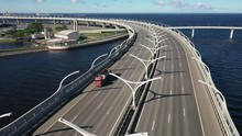Aerial View Of Cars Passing Over Bridge In Saint Petersburg Russia Overlooking The Gulf Of Finland