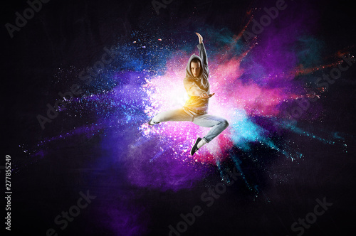 Keuken foto achterwand Dance School Modern female dancer jumping in hoodie with colourful splashes background. Mixed media