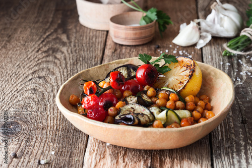 Fotografie, Obraz Healthy vegan bowl with grilled vegetables, and roasted chickpeas