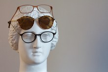 Glasses On A Plaster Mannequin Head On A Grey Background2