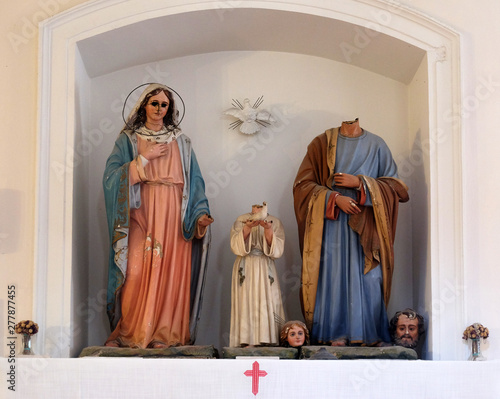 Holy Family, figures were ravaged on January 13th,1992, by the Serbian-Montenegrin invaders having previously burnt down Cilipi, church of St. Nicholas in Cilipi Wall mural