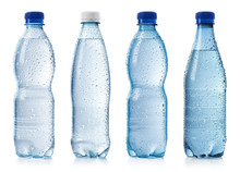 Collection Of Various Cold Bottles Of Water With Drops