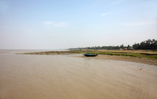 Boats Of Fishermen Stranded In The Mud At Low Tide On The Coast Of Bay Of Bengal, India