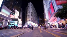 Hong Kong Times Square Intersection At Night Rush Hour People Crossing Street In Busiest Area Causeway Bay Hong Kong. Crowded Crosswalk Time Lapse Panorama Wide Shot.