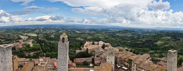 Fototapeta na wymiar Panoramic aerial view of the city and surrounding countryside from the towers of San Gimignano in Tuscany, Italy
