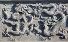 A White Wall With Dragon Stone Sculpture Background