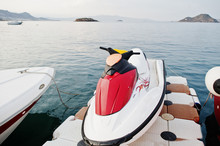Red And Whithe Jet Ski On A Calm Blue Sea Of Bodrum, Turkey.