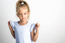 Beautiful Girl With Blond Hair In A Blue Dress, A 7 Year Old Child
