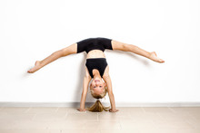 The Girl Is Engaged In Acrobatics, Sports Exercises For Children, Stretching Muscles