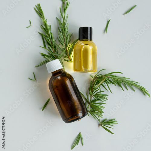 Fototapeta Bottles with rosemary essential oil. Herbal cosmetic treatment products. obraz na płótnie