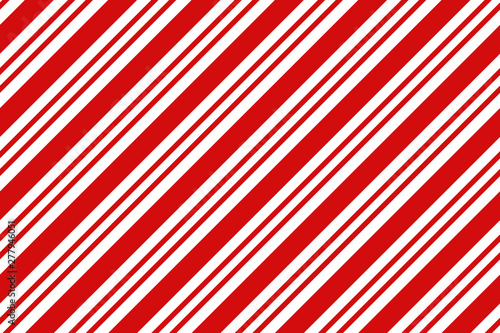 Fotografia  Christmas background. Red and white diagonal stripes pattern.