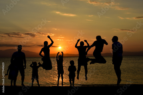 Fototapety, obrazy: silhouette of friends jumping on beach during sunset time
