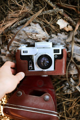 A vintage camera lying in t...