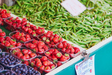 Fresh Strawberries, Green Peas And Blueberries For Sale On Local Food Market