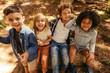Leinwanddruck Bild - Children having fun in forest