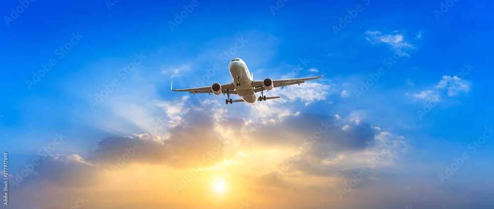 Fototapety, obrazy: Airplane in the sky at sunrise