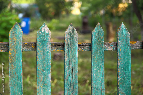 Background texture of old painted green paint wooden fence in the village Fototapet