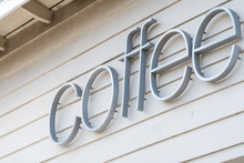 Generic Text Sign Of Coffee For Coffeehouse Shop On White Building Wall