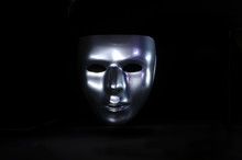 Silver Mask On Black Background