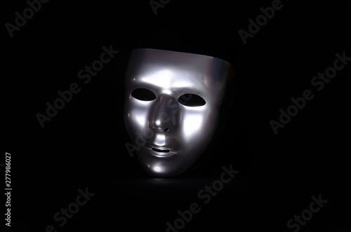 Fotografie, Tablou  shiny metal mask on black background