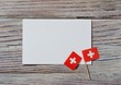 Switzerland, August 1. Federal holiday in honor of the Swiss Confederation. the concept of freedom, Alliance and Union. mini flags with sheets of white paper on wooden background. horizontal