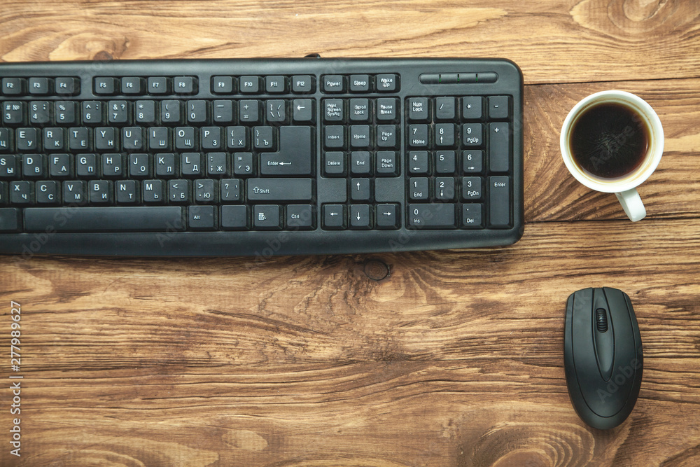 Fototapety, obrazy: Computer keyboard and coffee on wooden desk.