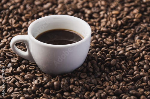 cup of coffee with beans background
